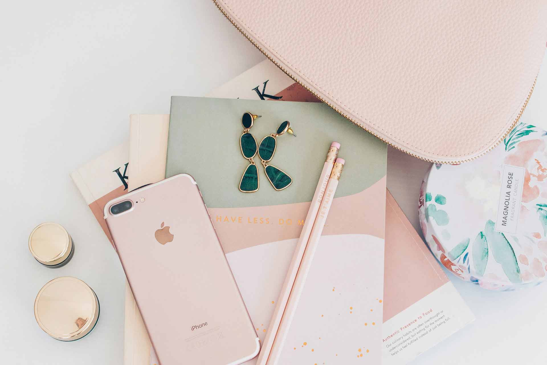 rose-gold-iphone-7-plus-beside-pencils-on-book-2897035